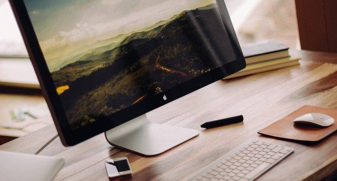 computer on a desk | adult education assessment toronto