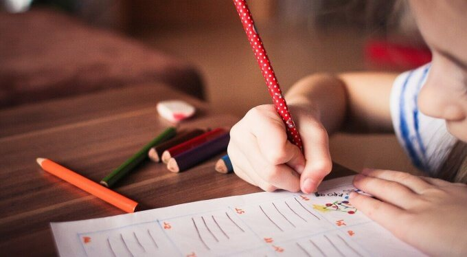 child holding pencil printing
