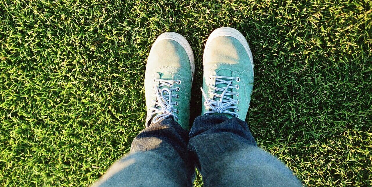 Teen Counselling | feet in sneakers in grass