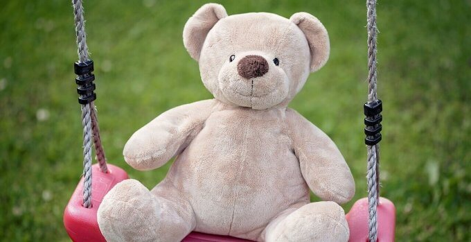 Child Centered Therapy | Teddy on a swing