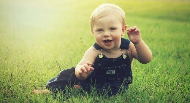 happy toddler in grass