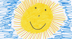 drawing of a smiling sun in a blue sky