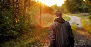 Person walking toward sunset